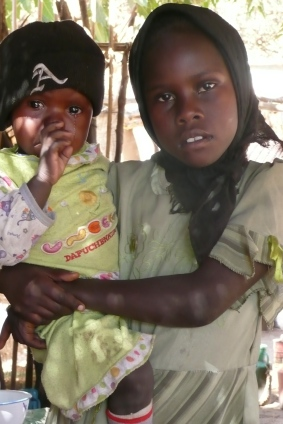Girl with baby in Kassab camp, N. Darfur